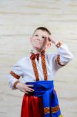 Child pointing up while wearing a folk costume — Stock Photo