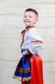Proud young boy in a colorful costume — Stock Photo