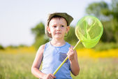 Boy in Field Holding Green Bug Net — Stock Photo
