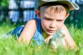 Young Boy Playing with Chick in Long Grass — Stock Photo