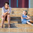 Boy Watching Mother Eat Ice Cream Cone on Steps — Stock Photo #75474353