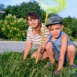 Mother and Son with Bug Net Exploring on Lawn — Stock Photo #75474385