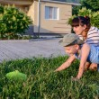 Mother and Son with Bug Net Exploring on Lawn — Stock Photo #75474393