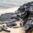 Pile of Scuba Diving Equipment Drying on Dock — Stock Photo #75904831