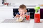 Young Boy Pushing Away Bowl of Breakfast Cereal — Stock Photo