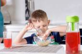 Boy Picking at Oatmeal Cereal at Breakfast Time — Stock Photo