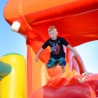 Small boy having fun on a jumping castle — Stock Photo #76900069