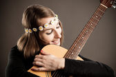 Young woman with acoustic guitar — Stock Photo