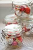 Home made pralines in jar — Stockfoto