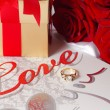 Golden diamond ring with gift box and red rose — Stock Photo #71745071