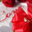 Golden diamond ring with gift box and red rose — Stock Photo #71745145