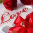 Golden diamond ring with gift box and red rose — Stock Photo #71745287
