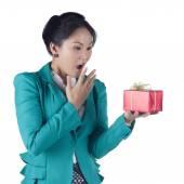 Portrait of beautiful Asian woman holding a gift box — Stock Photo