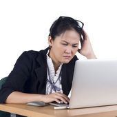 Bored business woman working on laptop looking very boring at th — Stock Photo
