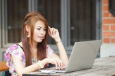 Young attractive business woman working on her laptop at outdoor — Stock Photo