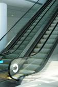 Empty escalator stairs in modern building — Stock Photo