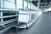 Trolleys luggage in a raw in airport — Stock Photo