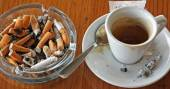 Cup of coffee espresso and ashtray chock — Stock Photo
