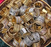 Pile ethnic rings sold at local market — Stock Photo