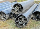 Plastic pipes for transporting water and gas — Stock Photo
