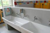 Sinks and washbasins with low taps in the toilets of a nursery — Stock Photo