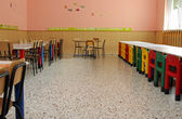 Tables and chairs in the refectory of the school canteen in a nu — Stock Photo