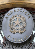 Logo of the Italian Embassy on the entry door with the symbol of — Stock Photo
