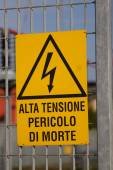 Danger high voltage sign in a Italian powerhouse — Stock Photo