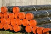 Huge pipes for laying electric cables and optical fibres in the  — Stock Photo