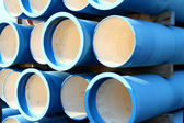 Blue tubes for waterworks and sewer system of the city — Stock Photo