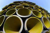 Yellow corrugated tube photographed with fisheye lens — Stock Photo