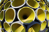 Many yellow corrugated tube photographed with fisheye lens — Stock Photo