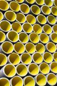 Many yellow corrugated pipes for laying electric cables and opti — Photo