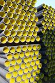 Yellow corrugated pipes for laying electric cables and optical f — Stock Photo
