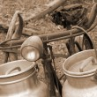 Bike of the milkman with old bins for milk sepia — Stock Photo #53891853