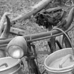 Rusty bike of the milkman with bins for milk — Stock Photo #53891855