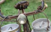 Old bike lights milkman with two aluminium cans for milk deliver — Stock Photo