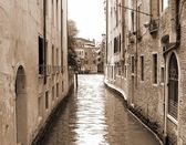 Narrow navigable canal in Venice in Italy sepia — Stock Photo