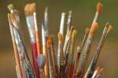 Set of brushes used by a painter in painting workshop — Stock Photo