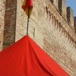 Tend yellow and red lines at the foot of the old castle walls — Stock Photo #55382153
