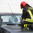 Italian firemen break the windshield of the car to release the i — Stock Photo #55508551