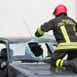 Italian firemen break the windshield of the car to release the i — Stock Photo #55508553