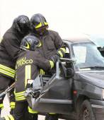 Firefighters open the door of the car with a pneumatic shears — Zdjęcie stockowe
