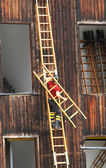 Fire-fighting Services tutorial with a firefighter and the stair — Stock Photo