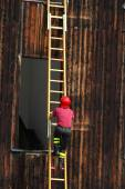Fireman during a demonstration of using the ladder to reach the  — Stock Photo
