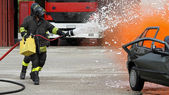 Firefighter with helmet off the car during a practice session — Foto Stock