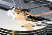 Hard disk failure with a band-aid over disks — Stock Photo