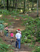 Happy family walks amidst nature during an excursion in the moun — Foto Stock