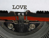 LOVE  written with black ink with the typewriter — Stock Photo