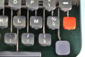 Red button of an ancient typewriter — Stock fotografie